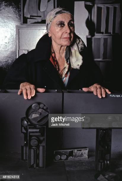 Sculptor Louise Nevelson photographed in her New York City studio in 1983