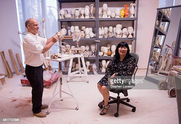 Sculptor Michael Evert creates a sculpture of designer Anna Sui as part of the Ralph Puccu The Art of the Mannequin exhibit at Museum of Arts and...