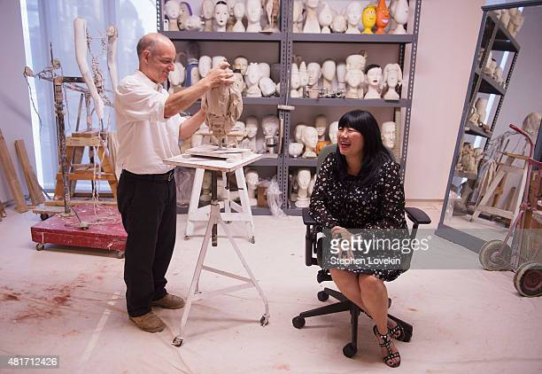 Sculptor Michael Evert creates a sculpture of designer Anna Sui as part of the Ralph Pucci The Art of the Mannequin exhibit at Museum of Arts and...