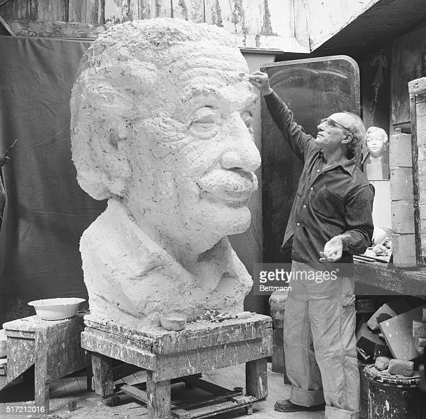 Sculptor Mitchell Fields puts finishing touches to a bust of the late scientist Albert Einstein in preparation for its unveiling, May 22nd, at a...