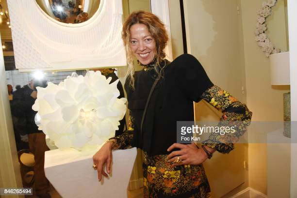 Sculptor Nathalie Ziegler Pasqua poses with her work during Nathalie Ziegler Pasqua Sculptures Exhibition Preview at Galerie Mougin on September 12...