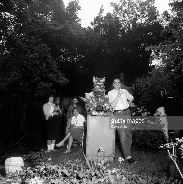 Sculptor Nathaniel Kaz and his wife and children pose for a portrait in the backyard of their brownstone at 36 Grace Court in Brooklyn Heights in...