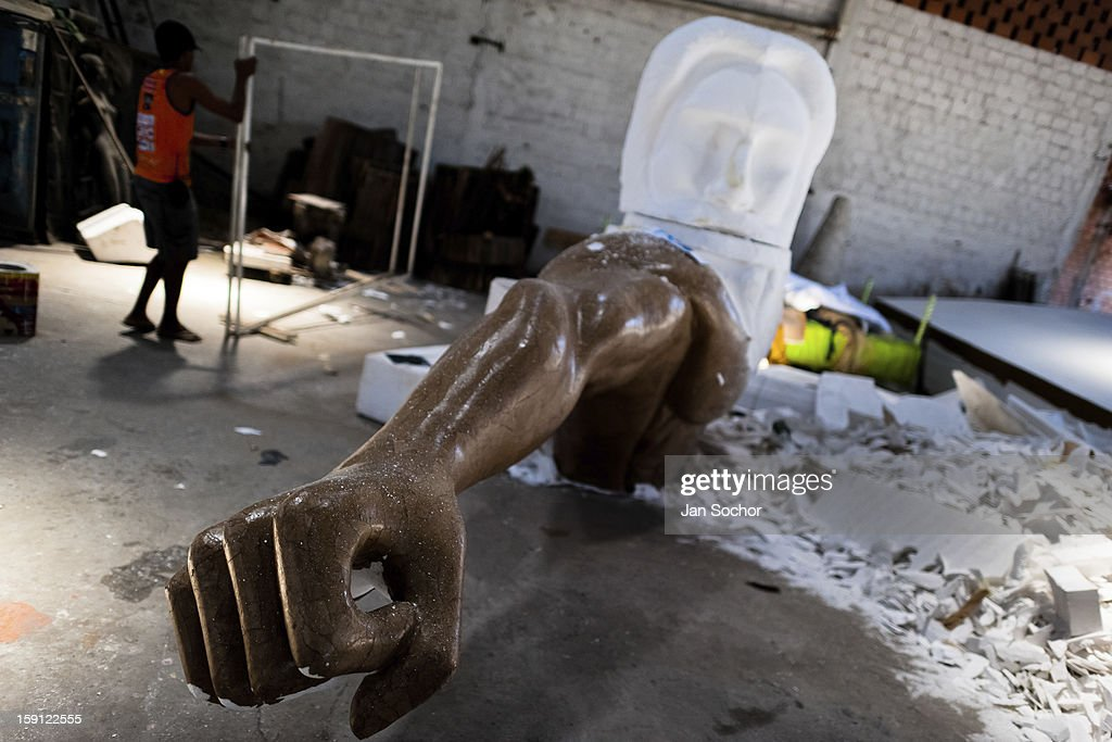 A sculptor of Acadêmicos da Rocinha samba school works on a carnival statue inside workshop in Rio de Janeiro, Brazil, 14 February 2012. The carnival preparations start early in July or August, some 7-8 months before the main samba schools parade at the sambodrome. Samba schools hire teams of professional designers and artists who, according to the original theme selected by the school directors and then featured by the school during the parade, create allegorical floats, costumes, sculptures, music, choreography and the entire school show. However, the most of the everyday work in the carnival hangars is performed by unknown but fully dedicated samba schools members.