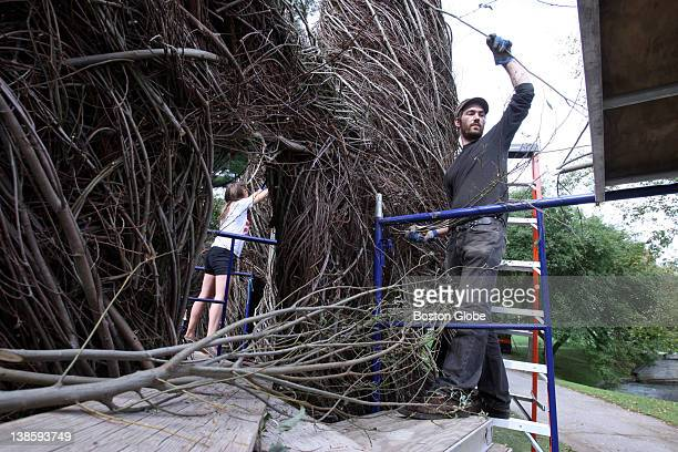 Sculptor Patrick Dougherty is creating a temporary installation made of twigs and branches from trees at Wheaton College Student Annie Laurie...