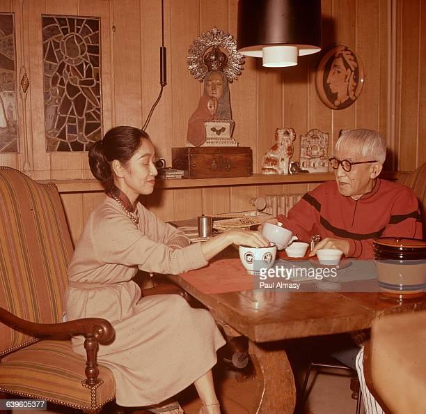 Sculptor Tsougharu Foujita and his wife having tea | Location Foujita's house in France