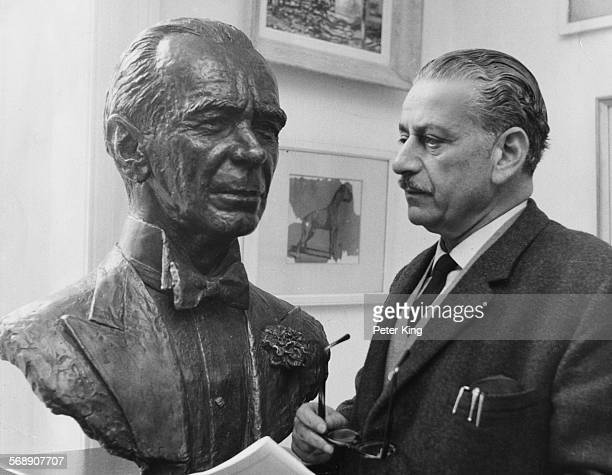 Sculptor William Timym with his bust of Sir Malcolm Sargent, on display at Royal Festival Hall in London, December 12th 1968.