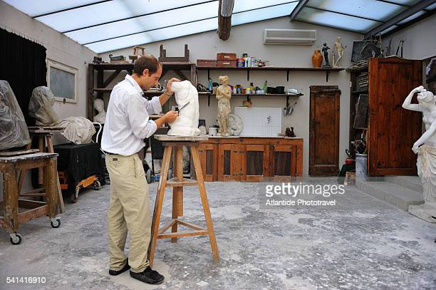 Sculptor working at the Raffaello Romanelli gallery and school