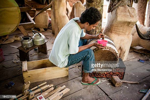CONTENT] Sculptor working in a workshop with buffalo statues in Tana Toraja Tana Toraja situated in the south of Sulawesi sometimes reminds alive...