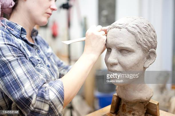 sculptor working on head sculpture - sculpture stock pictures, royalty-free photos & images
