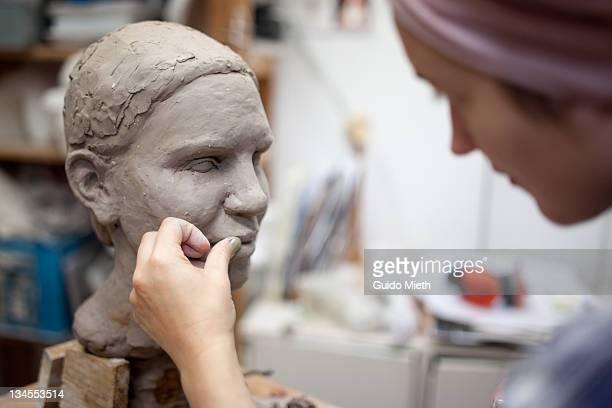 sculptor working on head sculpture - 彫刻家 ストックフォトと画像