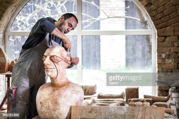 sculptor working on sculpture - sculptor stock pictures, royalty-free photos & images