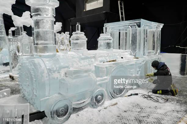 A sculptor works on an ice representation of a steam locomotive in the exhibition of ice sculptures on December 5 2019 in Zwolle Netherlands From...