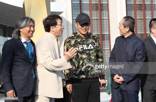 Sculptor Wu Weishan martial artist Jackie Chan actor Chen Daoming and director Zhang Yimou attend the unveiling ceremony of Golden Rooster sculpture...