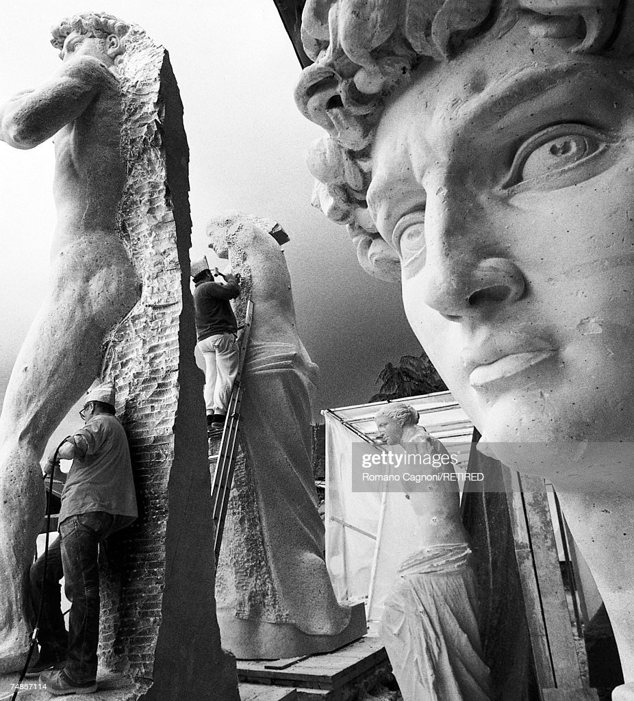 Sculptors at work on large, classical-style statues in Pietrasanta, Italy, 1990.