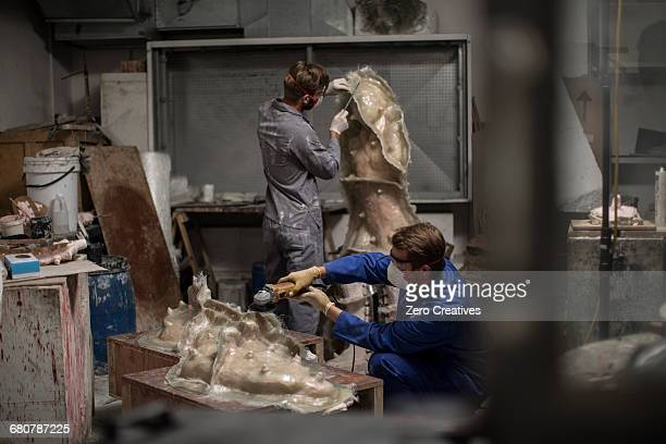 sculptors in artists studio creating sculptures - dungarees stock pictures, royalty-free photos & images