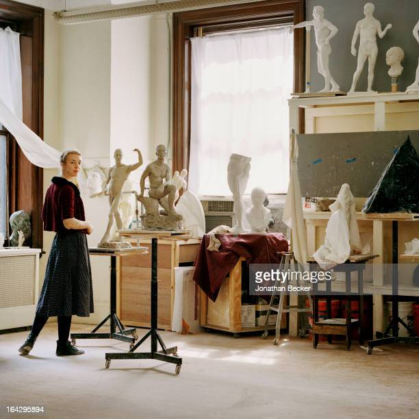 Sculptress Abigail Tulis is photographed for Vanity Fair Magazine in the Grand Central Academy in the General Society of Mechanics Tradesmen building...