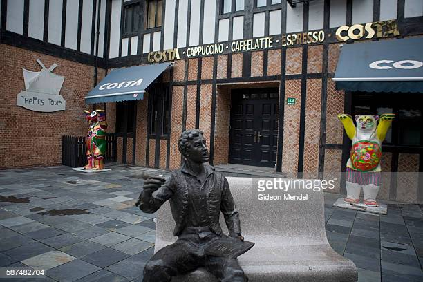 A sculpture and an empty Costa Coffee shopfront is part of the scenery in Thames Town an English village in China The architecture here imitates...