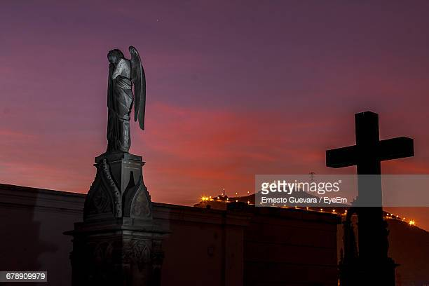 Sculpture And Cross At Presbitero Maestro During Sunset