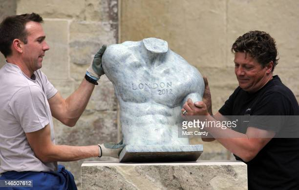 Sculpture Ben Dearnley and Richard Pike move a concept bronze of a 2012 Olympian into position in front of Salisbury Cathedral on June 18 2012 in...