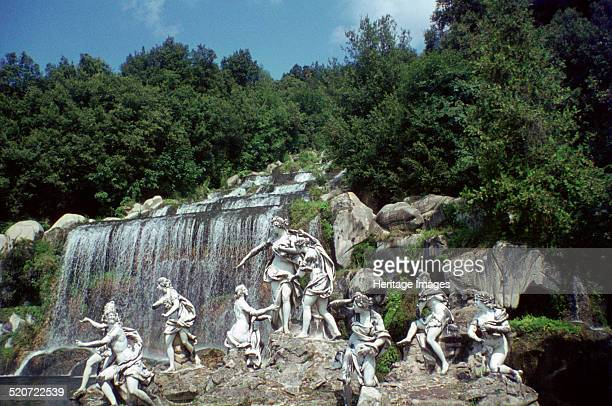 Sculpture by a cascade, Palace of Caserta, Campania, Italy. The Palace of Caserta was built in the 18th century for the Bourbon kings of Naples. It...