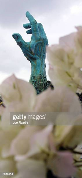 A sculpture by artist Kenneth Treister is on display depicting thousands of victims crawling into an open hand representing freedom April 29 2001 at...