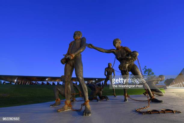 Sculpture by artist Kwame Akoto-Bamfo, part of the Nkyinkyim Installation, of enslaved people in chains is shown after entering The National Memorial...