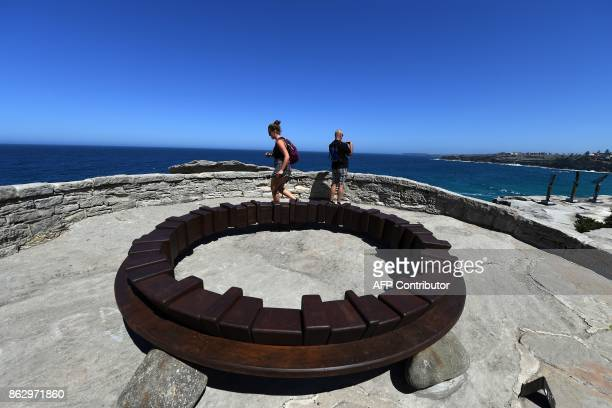 A sculpture by artist Tetsuro Yamasaki from Japan is seen at the 'Sculpture by the Sea' exhibition near Bondi beach in Sydney on October 19 2017 The...