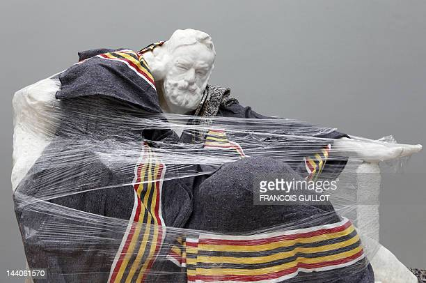 A sculpture by French sculptor Auguste Rodin is pictured on May 9 wrapped in plastic in a storage depot at the Rodin Museum in Paris prior to the...
