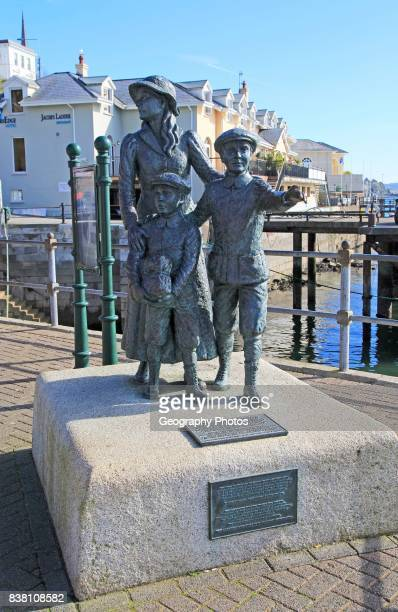 Sculpture by Jeanne Rynhart outside Heritage Centre Cobh County Cork Ireland Irish Republic Annie Moore and her brothers Anthony and Philip were the...