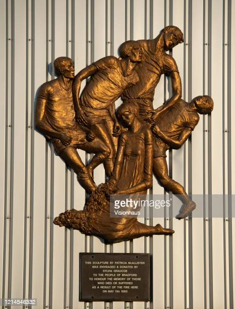 A sculpture by Patricia McAllister honouring the memory of those who died or suffered as a result of the fire at the stadium on 11th May 1985 at...
