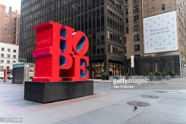 hope sculpture by robert indiana on the streets of midtown manhattan brings hope to new yorkers' minds and hearts. - alex potemkin coronavirus stock pictures, royalty-free photos & images