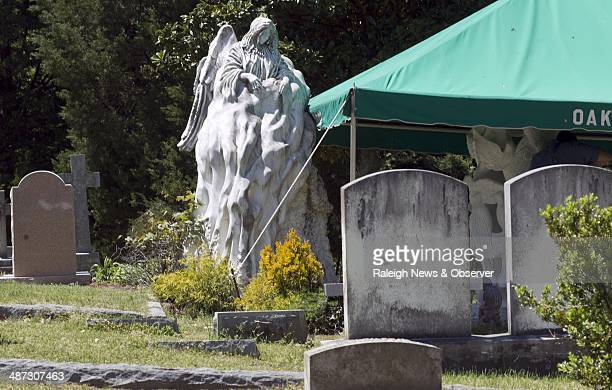A sculpture by Robert Mihaly at the grave of Wade Edwards the son of Elizabeth and John Edwards in the Oakwood Cemetery is seen April 24 2014 in...