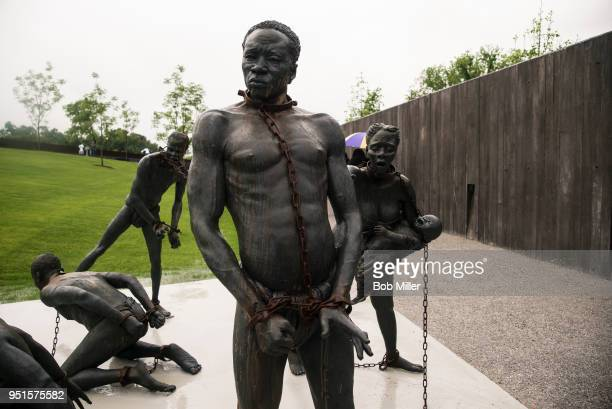 Sculpture commemorating the slave trade greets visitors at the entrance National Memorial For Peace And Justice on April 26, 2018 in Montgomery,...