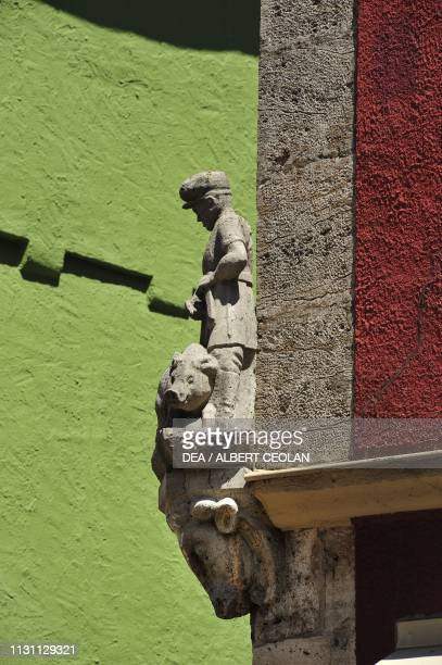 Sculpture depicting a butcher and a pig on the outer wall of a butcher's shop Rothenburg Ob Der Tauber Middle Franconia Bavaria Germany