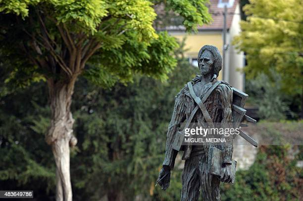 A sculpture depicting Dutch painter Vincent Van Gogh by Ossip Zadkine stands in AuverssurOise in the northwestern suburbs of Paris on August 11 2015...