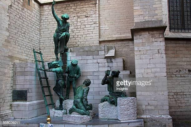 Sculpture depicting the workers outside Onze Lieve Vrouwekathedraal Antwerp Belgium