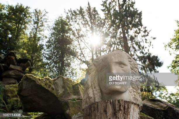A sculpture entitled Lion Woman by artist Emily Young features in the exhibition Chatsworth Outdoors Grounds for Sculpture in the grounds of...
