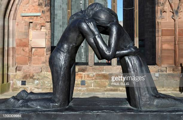 A sculpture entitled 'Reconciliation' stands in the ruins of 14th century Gothic Coventry Cathedral in Coventry central England on February 12 which...