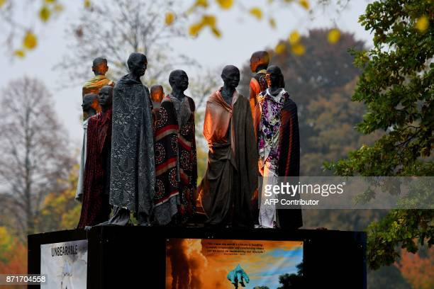 Sculpture featuring climate refugees created by Danish artist Jens Galschiot is seen at Rheinaue park during the COP23 United Nations Climate Change...