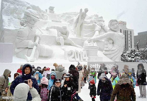 A sculpture featuring Japanese Olympians in the Sochi Games is displayed as a part of Sapporo Snow Festival in Odori Park on February 5 2014 in...
