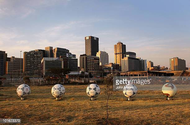 A sculpture featuring official World Cup soccer balls stands on display on June 4 2010 in downtown Johannesburg South Africa The capitol has been...
