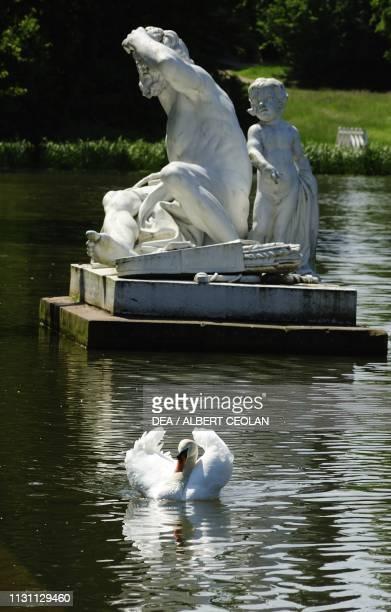 Sculpture in a pond garden of Schwetzingen Castle BadenWurttemberg Germany