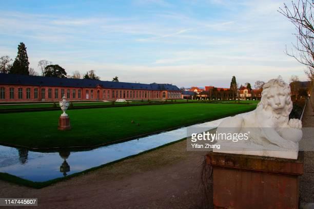 sculpture in front of the meadow in the schwetzingen palace - schwetzingen castle garden stock pictures, royalty-free photos & images