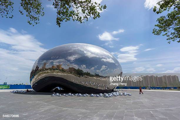 Sculpture in the shape of a giant oil bubble built near the first drilling well of the Karamay oil field is the landmark of the city which some...