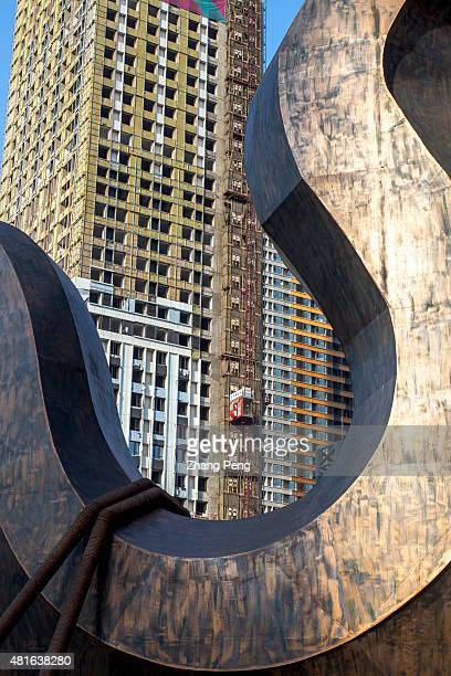 A sculpture of a crane hook in front of a new construction site In the first quarter of 2015 property investment in China slowed to 46 percent while...