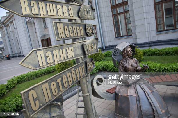A sculpture of a famous Soviet era singer and signs with distances to famous places is seen at Brest central station on 1 June 2017
