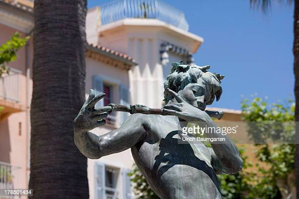 Sculpture of a flute player in front of a house facade on June 22 2013 in Bandol Cote d'Azur France
