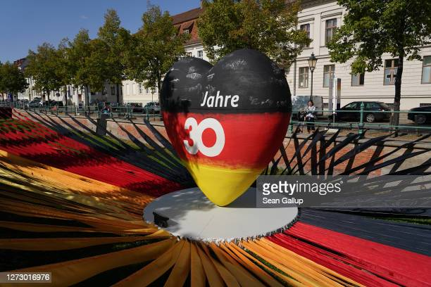 """Sculpture of a heart in the colors of the German flag reads: """"30 years"""" as part of an outdoor exhibition marking the upcoming 30th anniversary of..."""