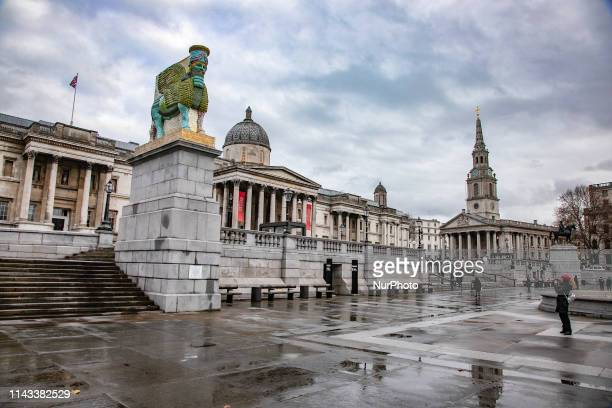 Sculpture of an ancient Assyrian Lamassu a mythological protective creature the Winged Bull with the head of a man on London Trafalgar Square 4th...