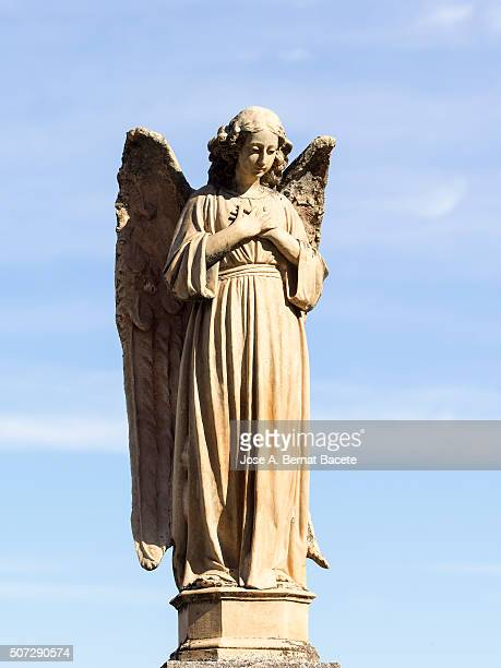 Sculpture of ancient stone of an angel in a cemetery